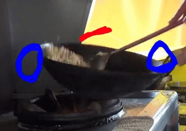Highly skilled: wok-frying rice is much more complicated than it appears.KO, ET AL